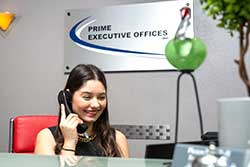 Woman Talking on phone at front desk